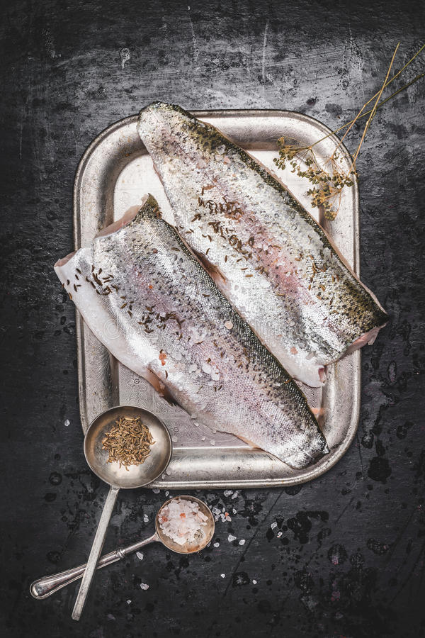 Download Raw Trout Fish Fillet With Fennel Seeds And Salt On Dark Rustic Background Stock Photo - Image: 83702903
