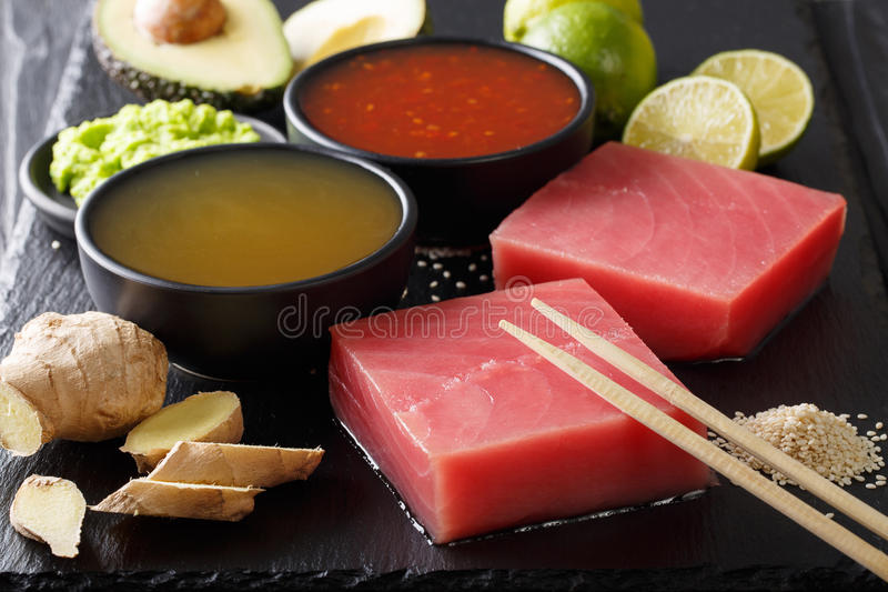 Raw tuna fillet with sauces and other ingredients for cooking cl royalty free stock images