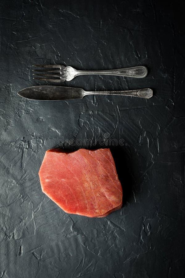 Raw Tuna Steak on Dark Background royalty free stock images