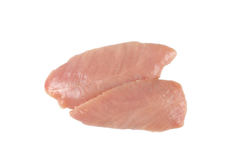 Raw turkey breast fillets. On white plastic cutting board stock images