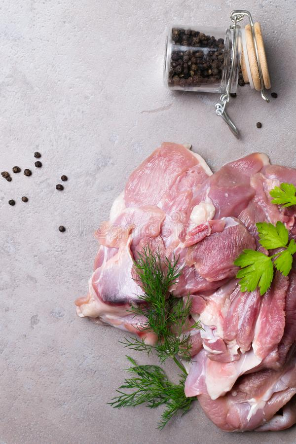 raw turkey or chicken fillets meat on grey cutting board with dill and lettuce stock photography