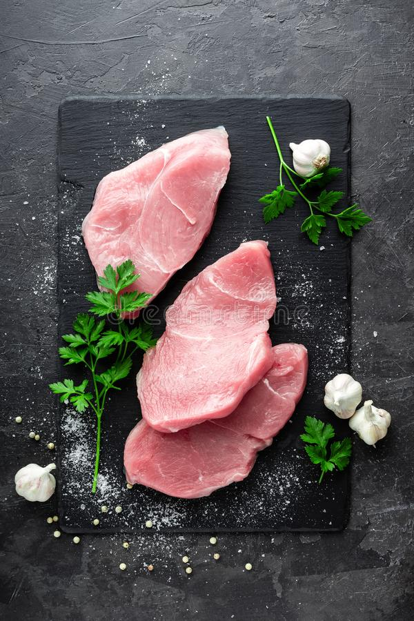 Raw turkey meat. Fresh turkey meat steakes sliced royalty free stock images