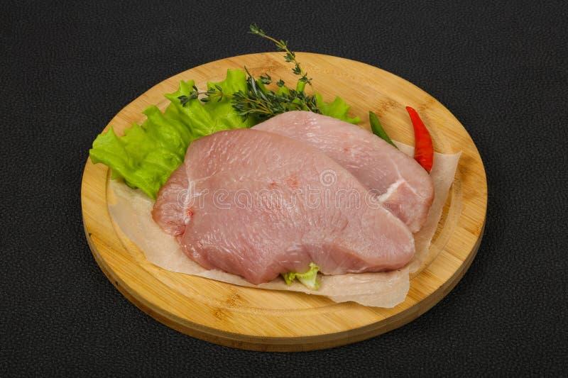 Raw turkey steak. Ready for grill stock image
