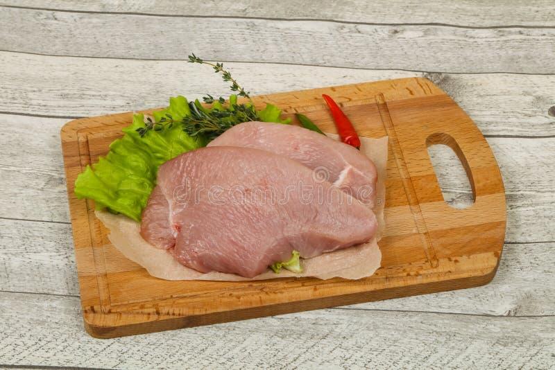 Raw turkey steak. Ready for grill stock photos