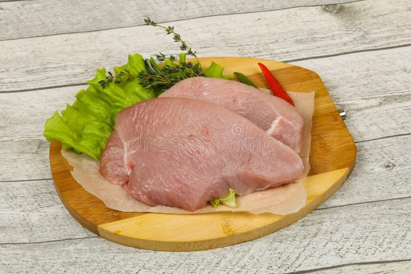 Raw turkey steak. Ready for grill royalty free stock photo
