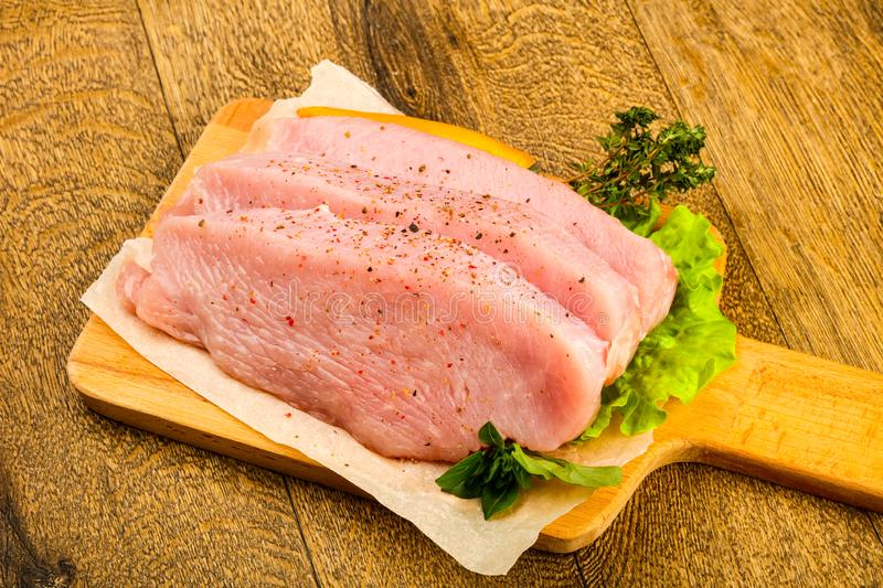 Raw turkey steak. With spices ready for grill stock image