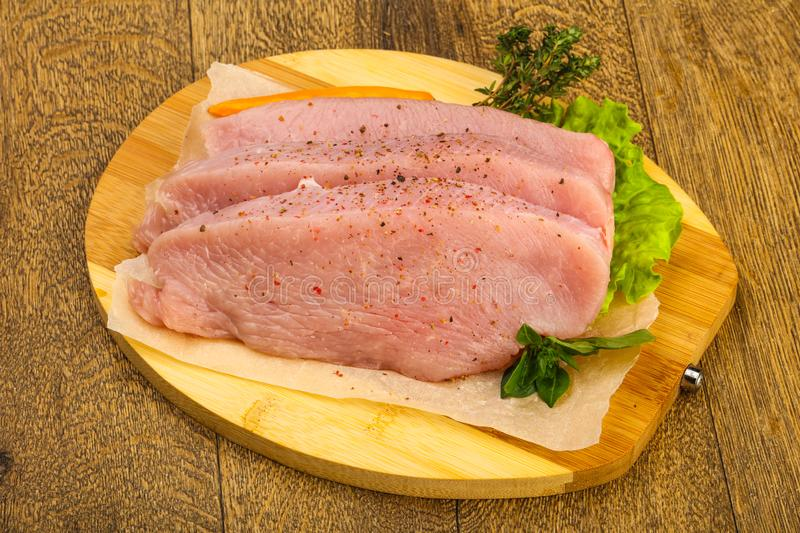 Raw turkey steak. With spices ready for grill stock photo