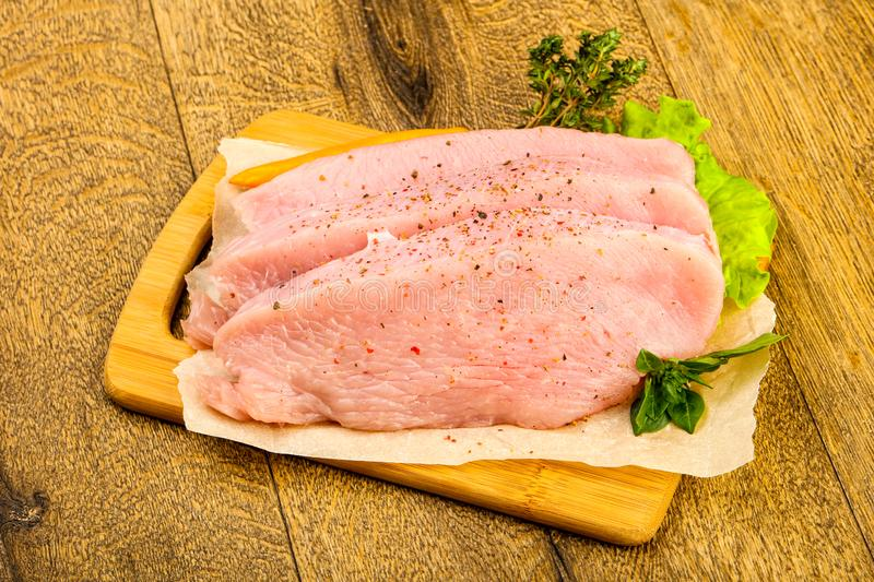 Raw turkey steak. With spices ready for grill stock photography