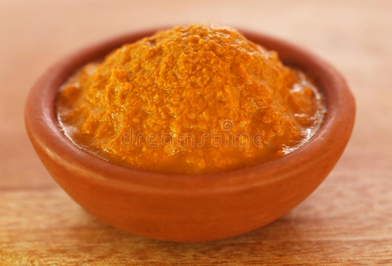 Raw turmeric paste in a bowl stock photo