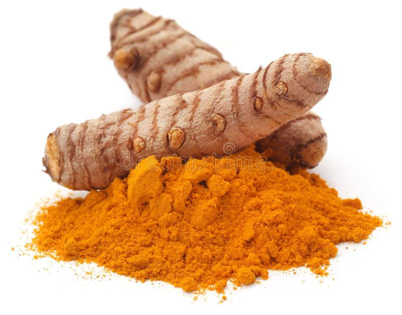 Raw turmeric with powder. Over white background royalty free stock image