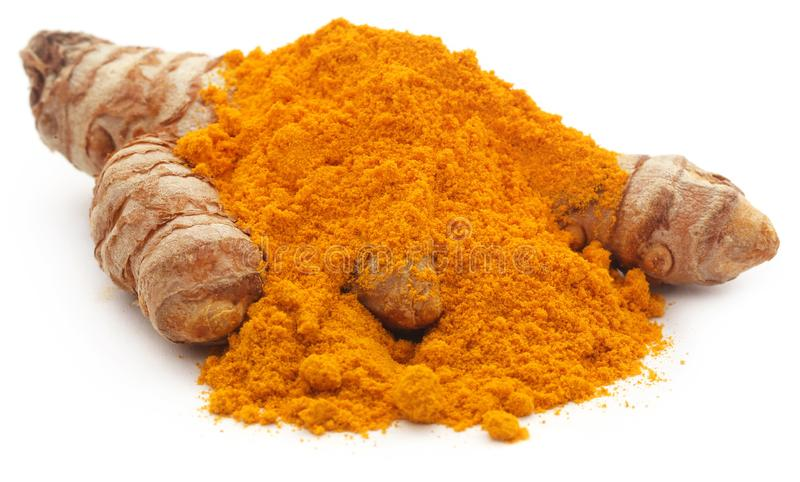 Raw turmeric with powder. Over white background royalty free stock images