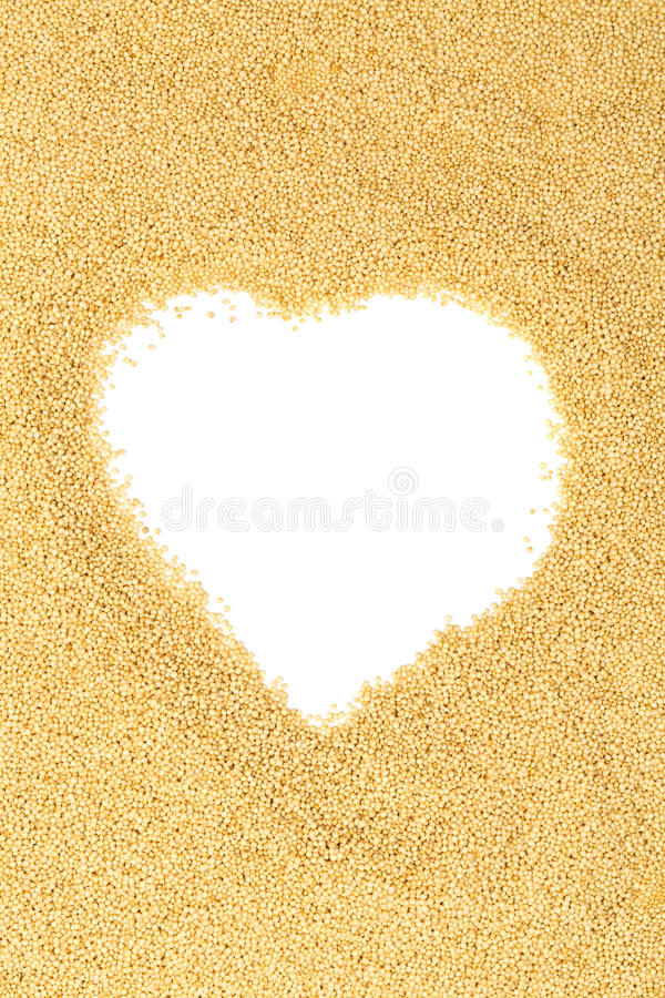 Raw, uncooked amaranth seeds heart stock photography