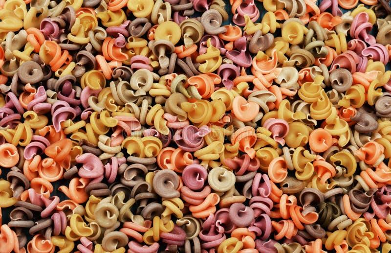 Raw uncooked italian pasta multicolored. royalty free stock image