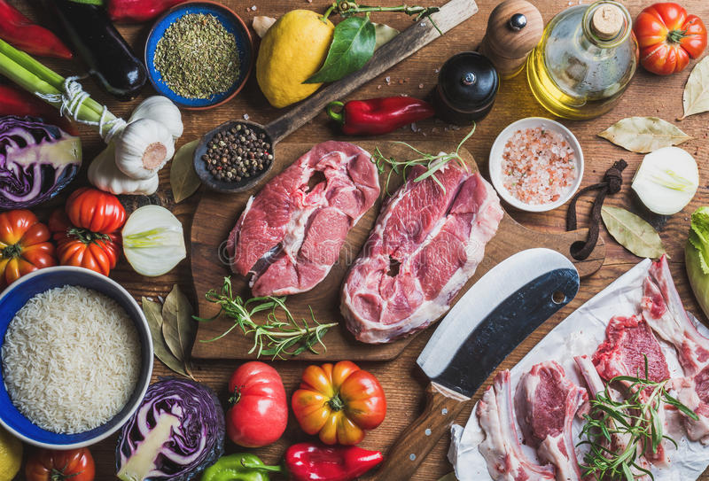 Raw uncooked lamb meat assortment, rice, olive oil, vegetables, spices royalty free stock photography
