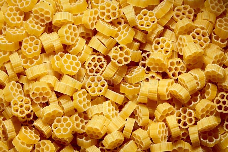 Raw uncooked Rotelle dry italian pasta. Ruote, wagon wheel shape. D stock photos