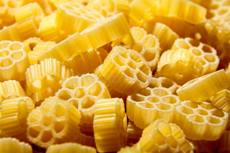Raw uncooked Rotelle dry italian pasta. Ruote, wagon wheel shape. D stock images