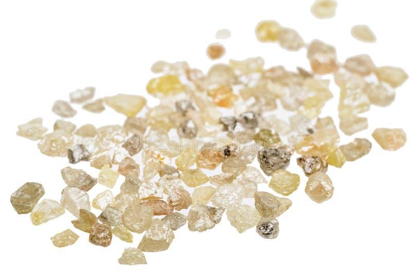 Raw uncut diamonds. A pile of raw, uncut natural diamonds on white stock photos