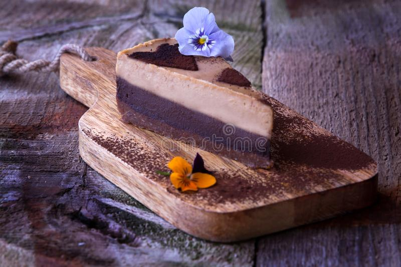 Raw Vegan Cake. Delicious slice of a raw vegan cake with a comestible flower royalty free stock photography
