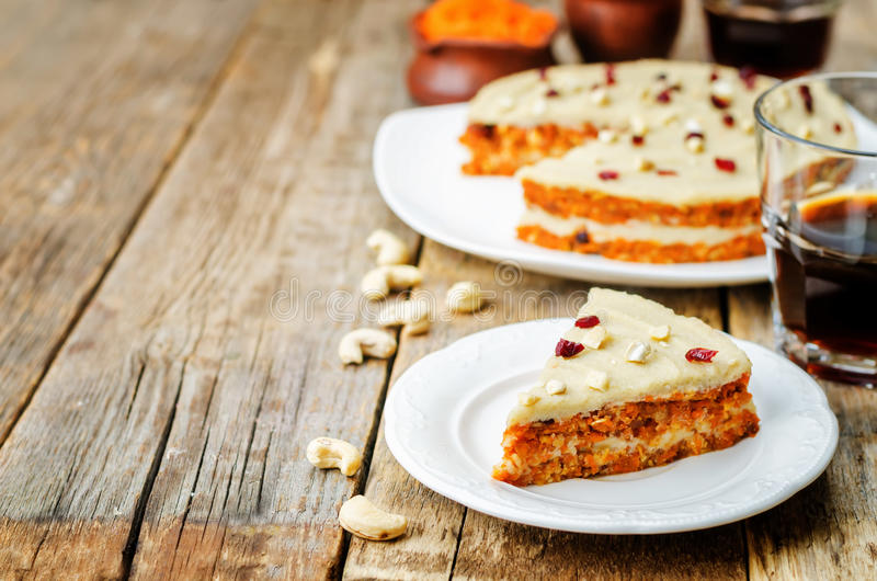 Raw vegan carrot cake with cashew cream and dried cranberries royalty free stock photo
