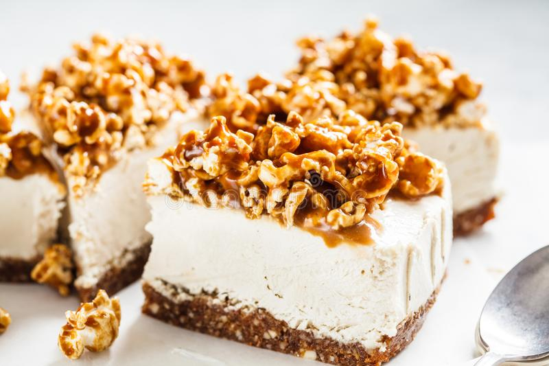 Raw vegan cashew cheesecake with caramel popcorn. Raw vegan dessert concept. Raw vegan cashew cheesecake with coconut caramel popcorn. Raw vegan dessert concept stock images