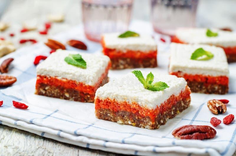 Raw vegan cashew godji berries pecan dates bars stock photos