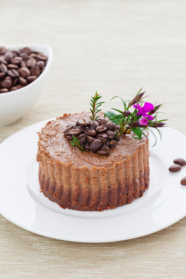 Raw vegan coffee tart. With cacao and mixed nuts royalty free stock photography