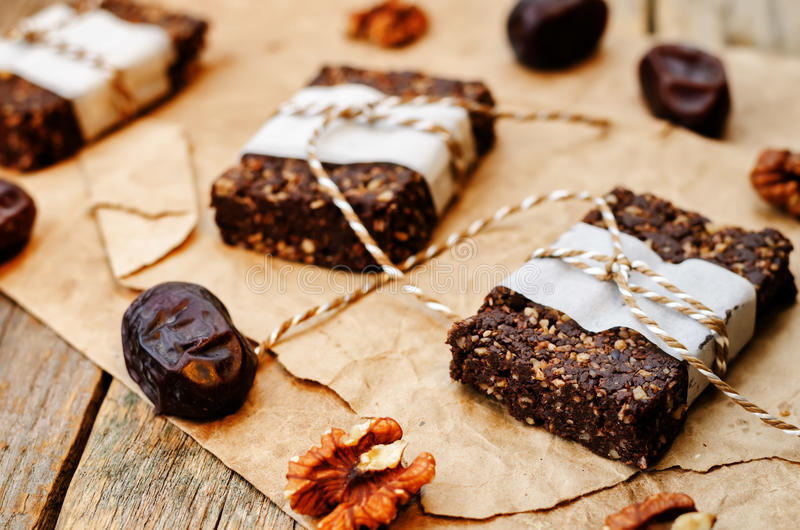 Raw vegan dates coconut walnut chocolate bars. Toning. selective focus stock images