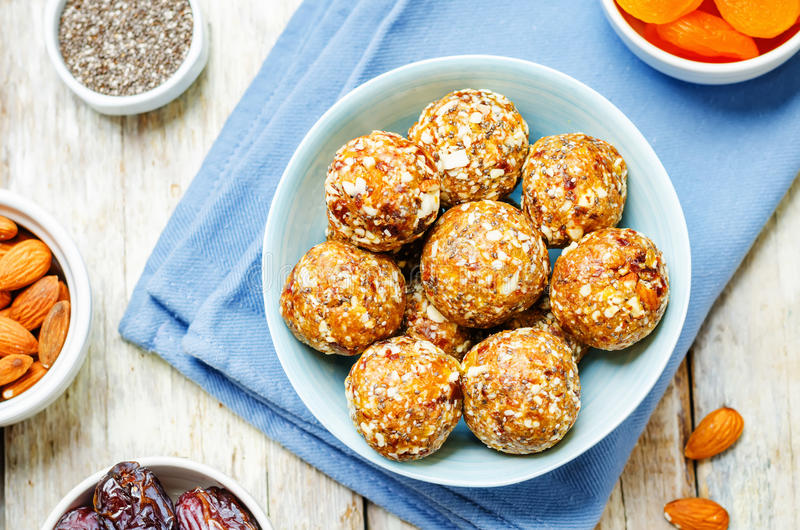 Raw vegan dried apricots, dates, almonds Chia seed balls. Toning. selective focus royalty free stock photos