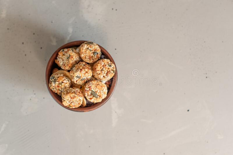 Raw vegan healthy dessert, date and nuts bliss balls, ingredients. Top view, space for text royalty free stock photo