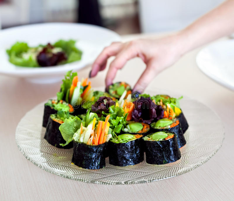 Raw vegan sushi rolls with vegetables royalty free stock photos