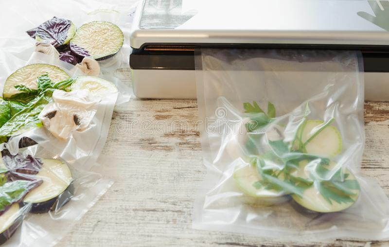 Raw vegetables and mushroom in vacuum package. Sous-vide, new technology cuisine. Horizontal stock photos