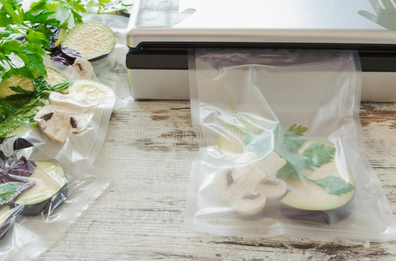 Raw vegetables and mushroom in vacuum package. Sous-vide, new technology cuisine. Horizontal stock image