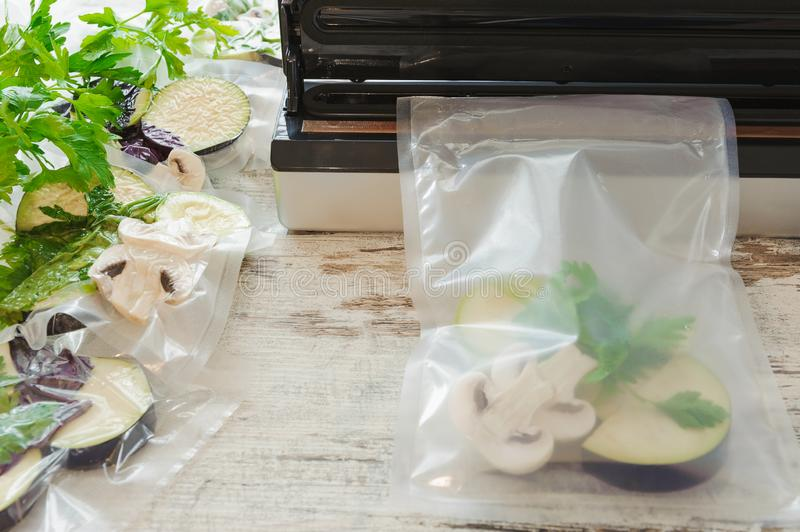 Raw vegetables and mushroom in vacuum package. Sous-vide, new technology cuisine. Horizontal royalty free stock photo