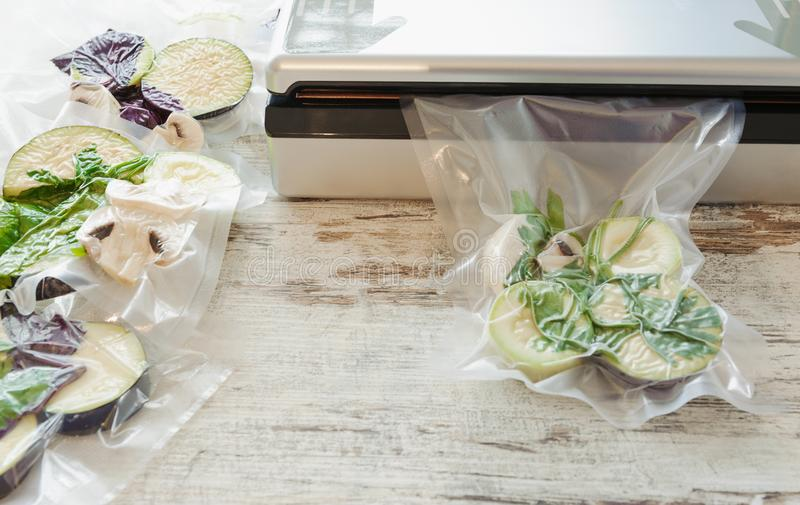 Raw vegetables and mushroom in vacuum package. Sous-vide, new technology cuisine. Horizontal stock photo