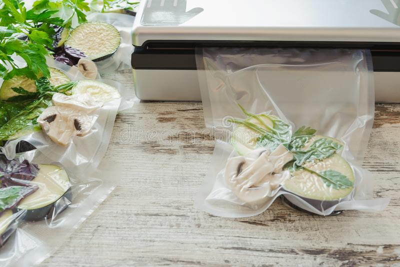 Raw vegetables and mushroom in vacuum package. Sous-vide, new technology cuisine. Horizontal stock images