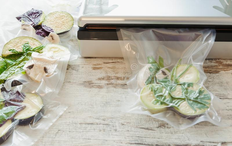 Raw vegetables and mushroom in vacuum package. Sous-vide, new technology cuisine. Horizontal royalty free stock image