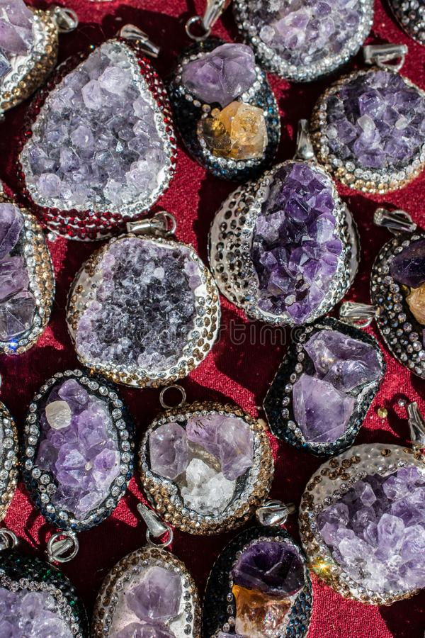 Raw violet amethyst rock with crystal ametist. Raw violet amethyst rock as a necklace stock image