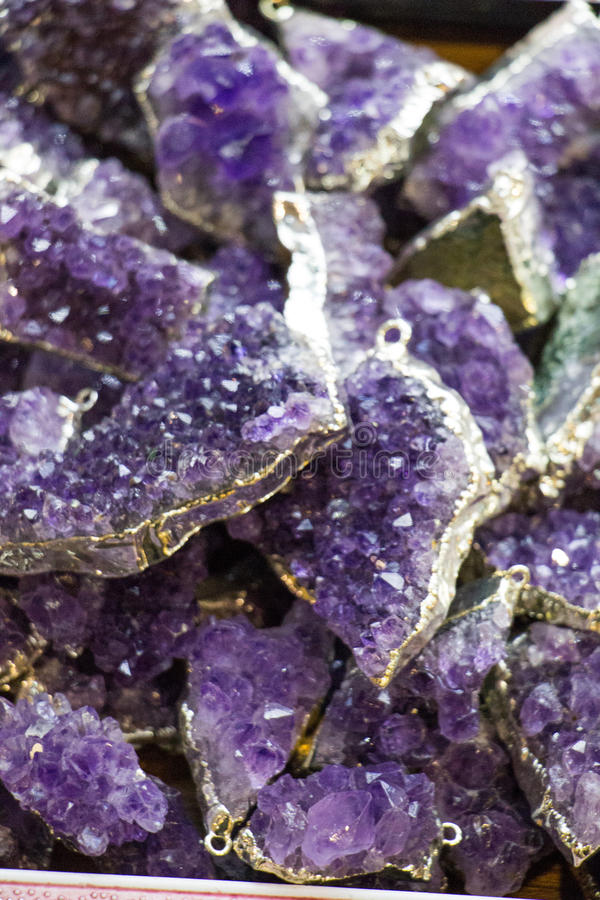 Raw violet amethyst rock with crystal ametist. Esoteric royalty free stock images