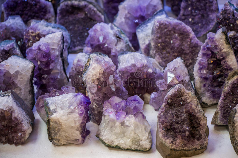 Raw violet amethyst rock with crystal ametist. Esoteric royalty free stock photos