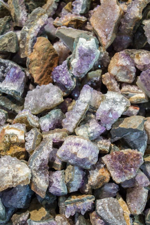 Raw violet amethyst rock with crystal ametist. Esoteric stock images