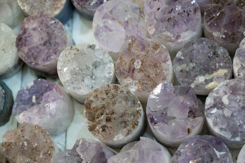 Raw violet amethyst rock with crystal ametist. Esoteric royalty free stock photography