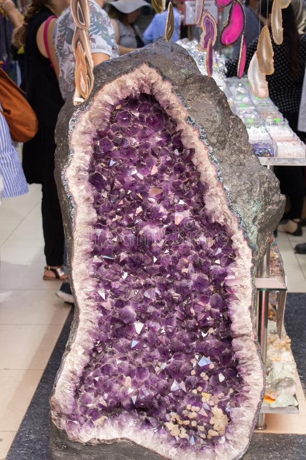 Raw violet amethyst rock with crystal ametist. Esoteric royalty free stock image