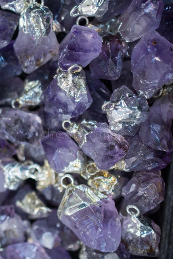 Raw violet amethyst rock with crystal ametist. Esoteric royalty free stock photo