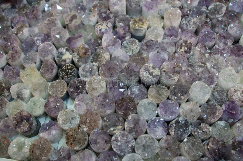 Raw violet amethyst rock with crystal ametist. Esoteric stock photo