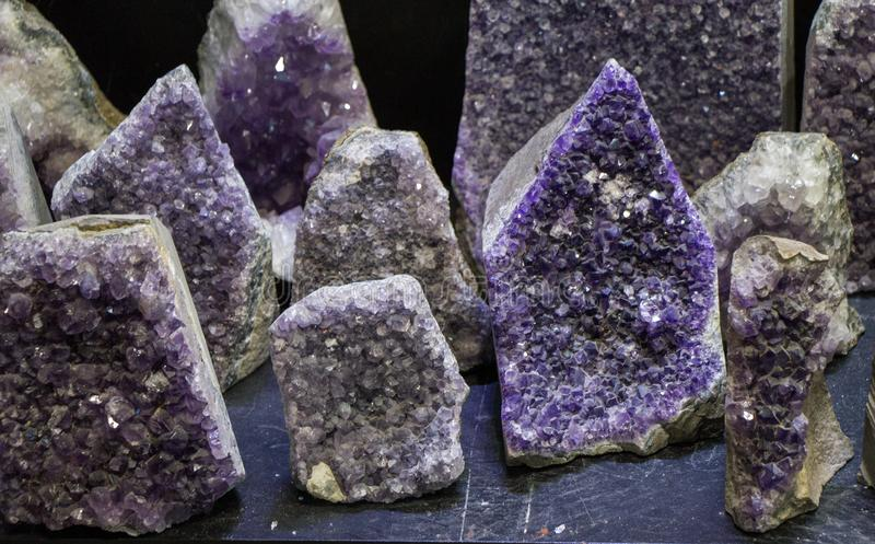 Raw violet amethyst rock with crystal ametist. Esoteric stock photos