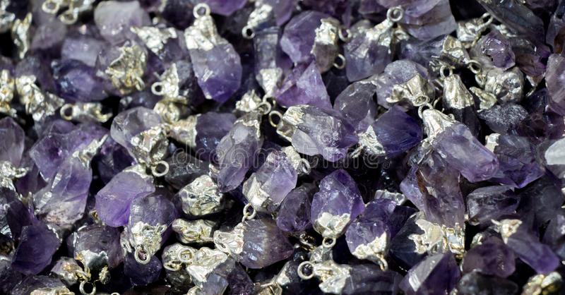 Raw violet amethyst rock with crystal ametist. Esoteric stock photography