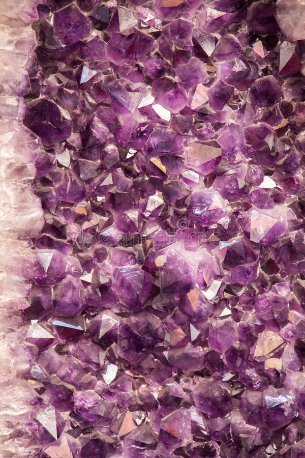 Raw violet amethyst rock with crystal ametist. Esoteric stock image
