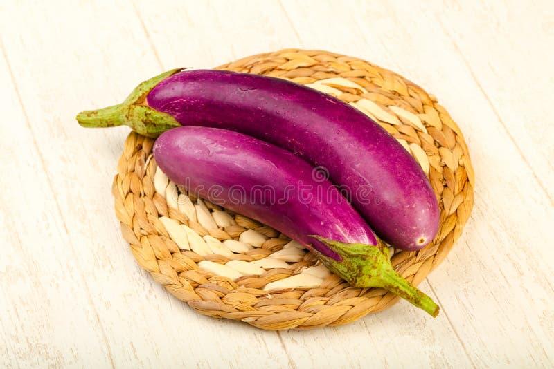 Raw violet eggplant royalty free stock photos