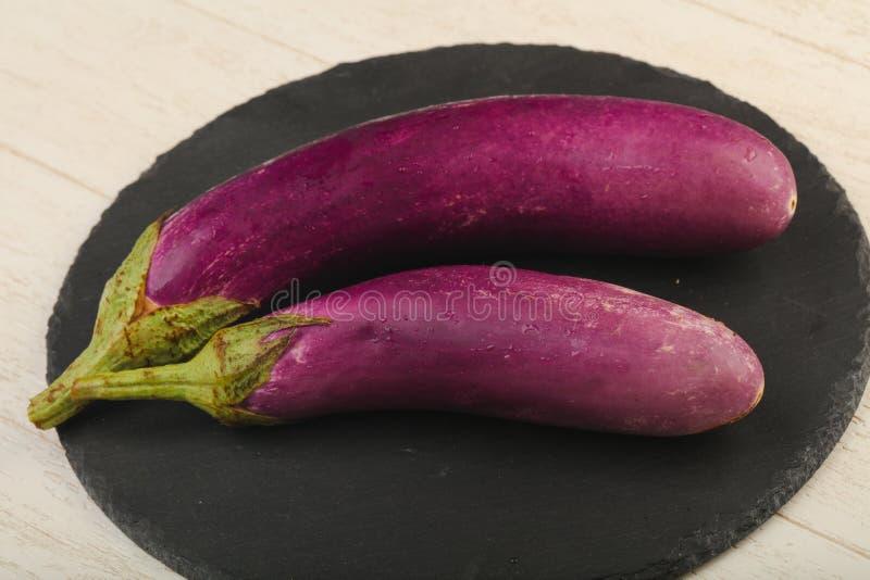 Raw violet eggplant royalty free stock photo