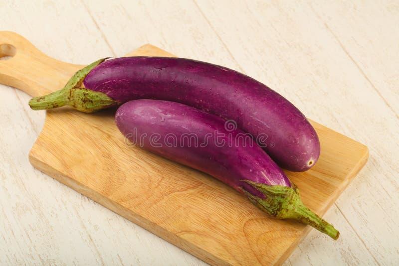 Raw violet eggplant stock photo